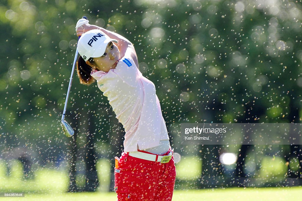 Mamiko Higa of Japan hits approach shot on the 18th hole on the training day of the Nitori Ladies 2016 at the Otaru Country Club on August 23 2016 in...