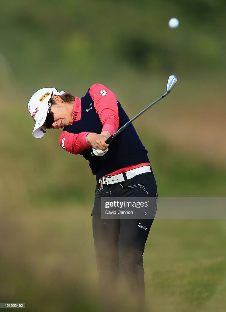 Mamiko Higa of Japan hits her 2nd shot on the 3rd hole during the first round of the Ricoh Women's British Open at Royal Birkdale on July 10 2014 in...
