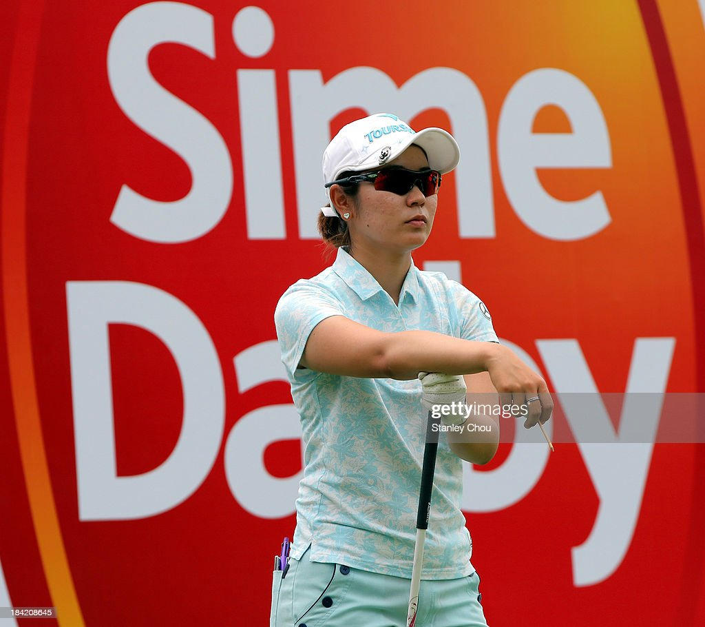 Mamiko Higa of Japan looks on the 9th hole during day three of the Sime Darby LPGA at Kuala Lumpur Golf Country Club on October 12 2013 in Kuala...