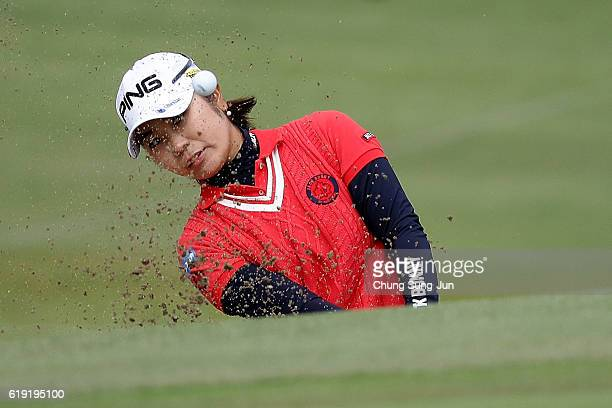 Mamiko Higa of Japan plays a bunker shot on the 9th hole during the final round of the Mitsubishi Electric/Hisako Higuchi Ladies Golf Tournament at...