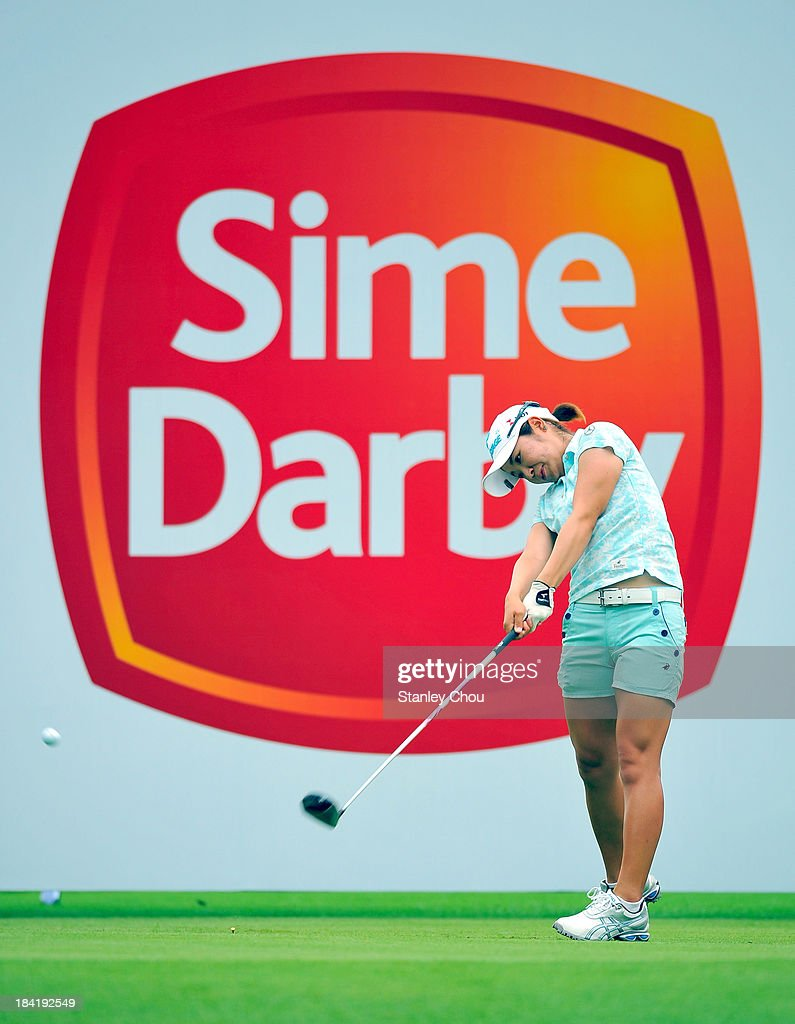 Mamiko Higa of Japan plays her tee shot on the 1st hole during day three of the Sime Darby LPGA at Kuala Lumpur Golf Country Club on October 12 2013...