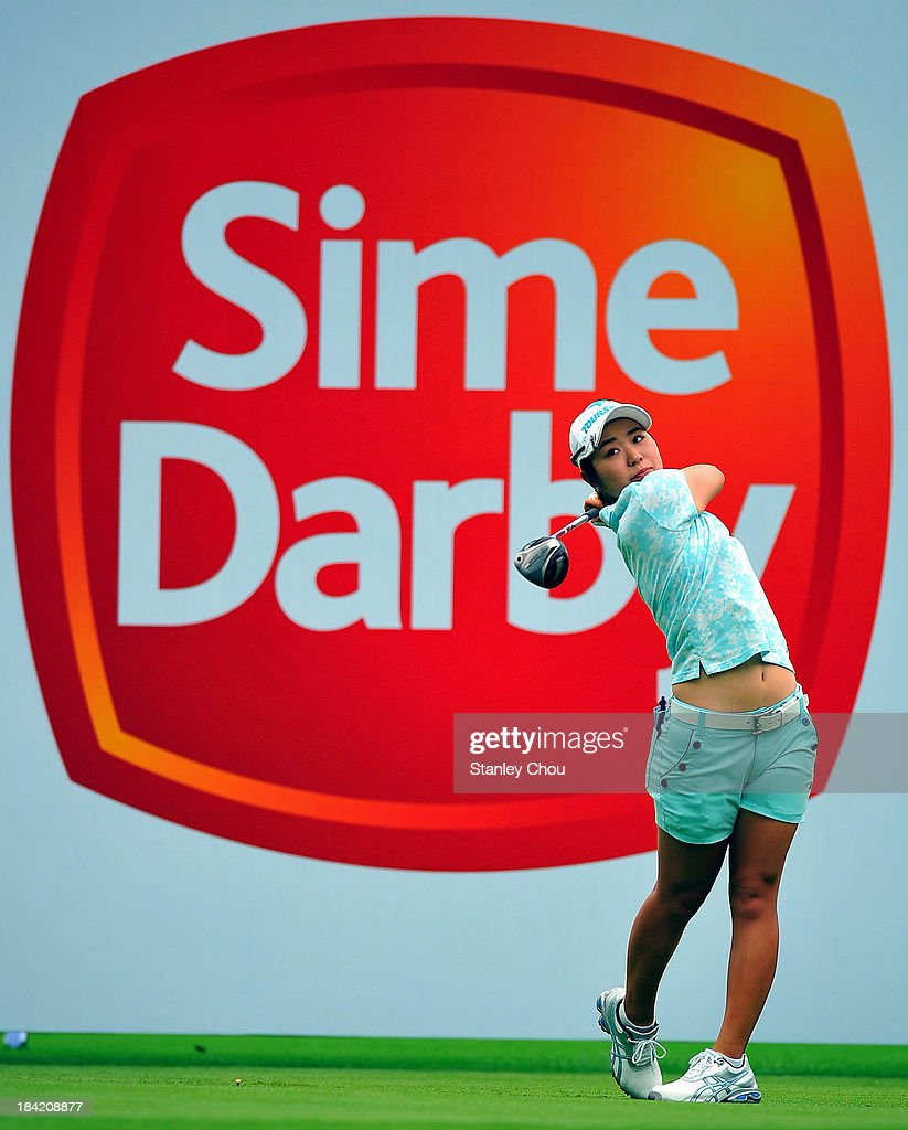 Mamiko Higa of Japan tees off on the 1st hole during day three of the Sime Darby LPGA at Kuala Lumpur Golf Country Club on October 12 2013 in Kuala...