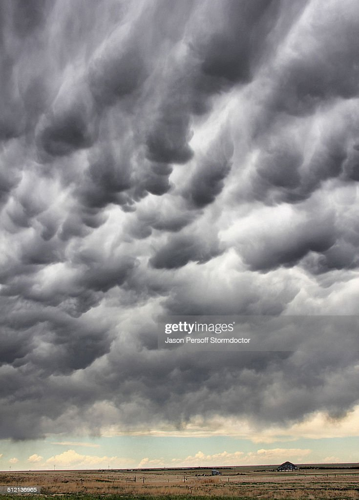 Mammatus clouds hang in the sky over rural farmstead, Cheyenne Wells, Colorado, USA