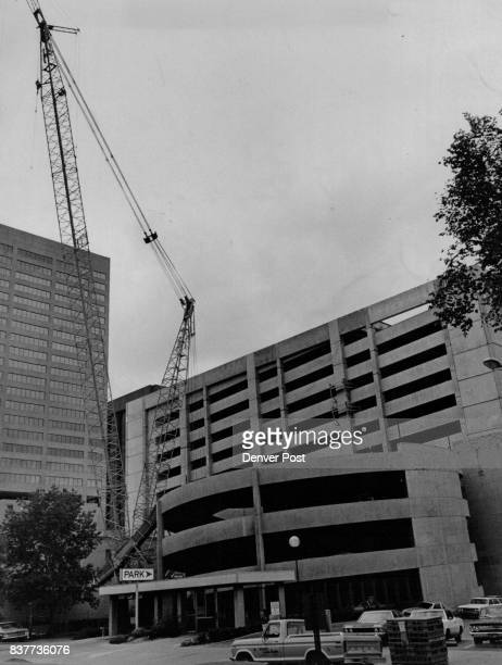 Mammoth Crane Waits For Next Job Standing at one side of its most recently completed project the 14story parking structure for United Bank of Denver...