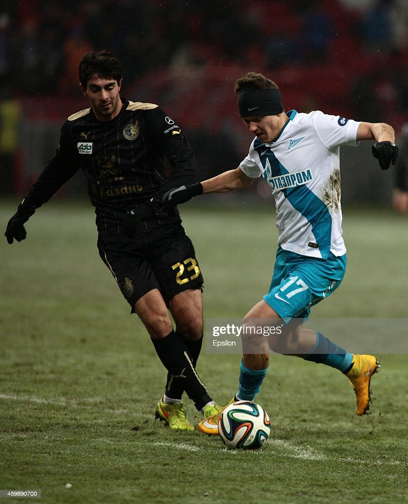 Mamuka Kobakhidze (L) of FC Rubin Kazan is challenged by <a gi-track='captionPersonalityLinkClicked' href=/galleries/search?phrase=Oleg+Shatov&family=editorial&specificpeople=9633751 ng-click='$event.stopPropagation()'>Oleg Shatov</a> of FC Zenit Saint Petersburg during the Russian Football League Championship match between FC Rubin Kazan and FC Zenit Saint Petersburg at the Kazan Arena on December 03, 2014 in Kazan, Russia.