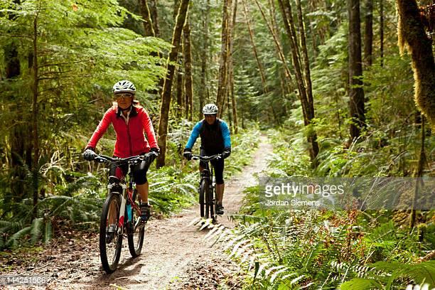 A man a woman bike riding.