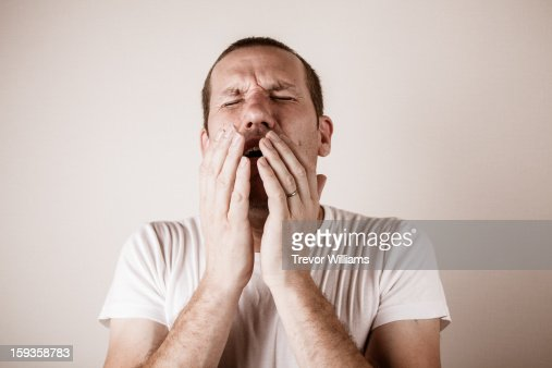A man about to sneeze : Foto de stock