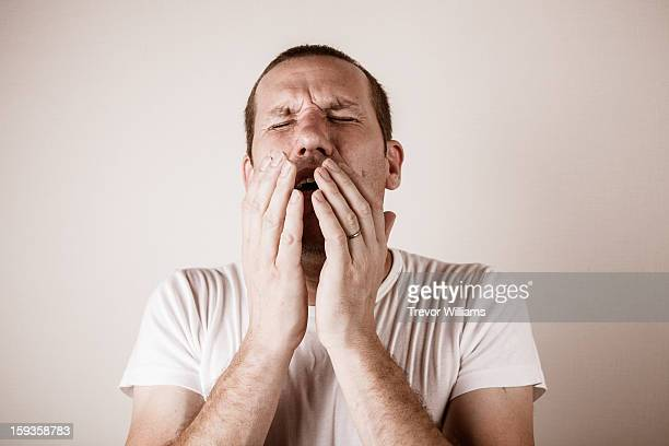 A man about to sneeze