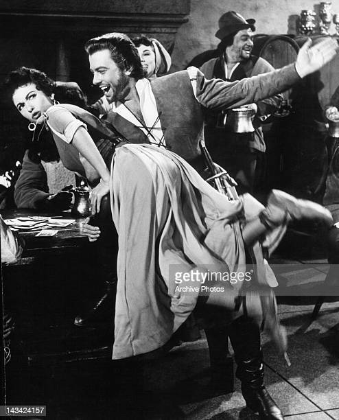 Man about to spank Rita Moreno in a scene from the film 'The Vagabond King' 1956