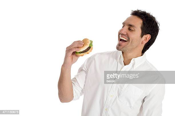 A man about to take a bite of a hamburger