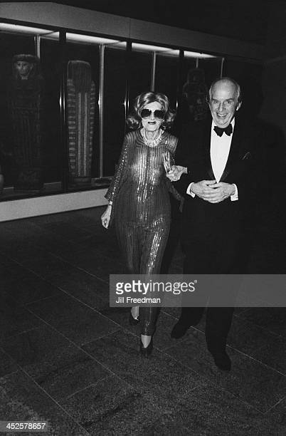 A man accompanies an elderly woman to an event being held at the Metropolitan Museum of Art New York City 1983
