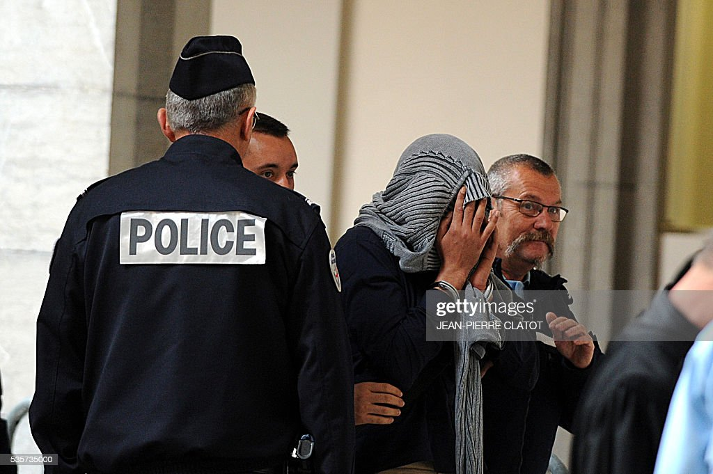 A man accused of armed robbery arrives at the Assises court in Chambery on May 30, 2016 to attend the trial of four armed robbers who are accused of killing a police officer of the French police's organized crime squad (BAC) during a robbery of electronics and white goods company Darty, in Chambery, southeast France. A police officer of the French police's organized crime squad (BAC) was killed in April 2012 by armed robbers who hit him with their car after they robbed electronics and white goods company Darty. / AFP / JEAN