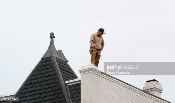 A man acting as security looks from the roof of the building serving as office space where white nationalist Richard Spencer was speaking to select...