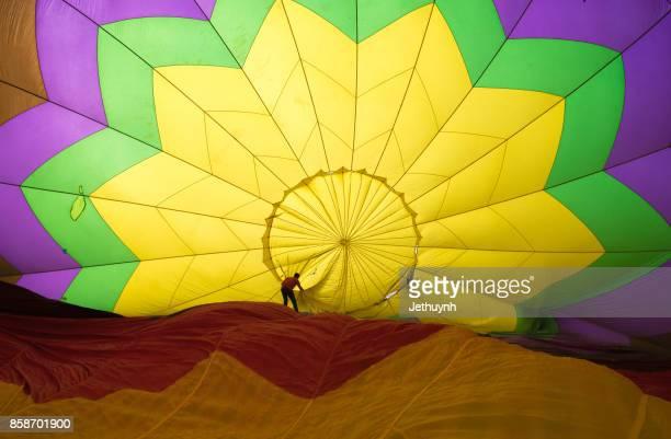 Man adjusting a hot air balloon in Ho Chi Minh City
