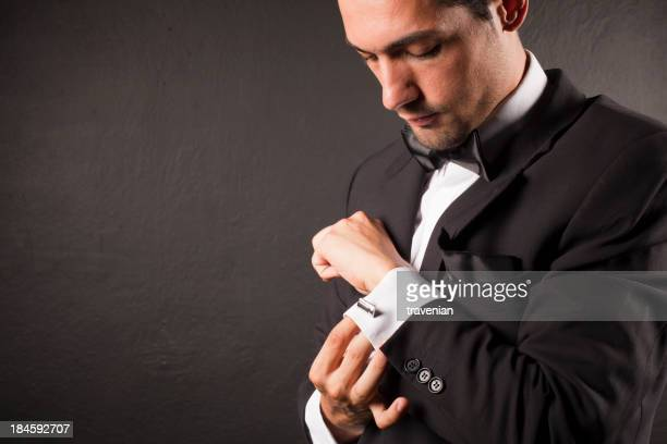 Man Adjusting Cufflink