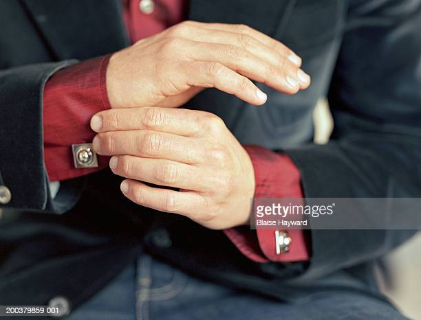 Man adjusting cuffs, close-up