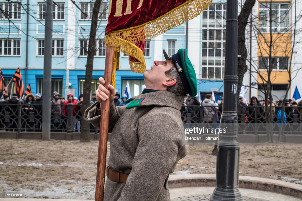 A man adjusts a flag during a pro-government march on March 2, 2014 in Moscow, Russia. After Ukraine's president Viktor Yanukovych was ousted last week following months of protests, Russia's military moved to protect what is seen as its interests in Crimea and eastern Ukraine, which have strong ties to Russia.