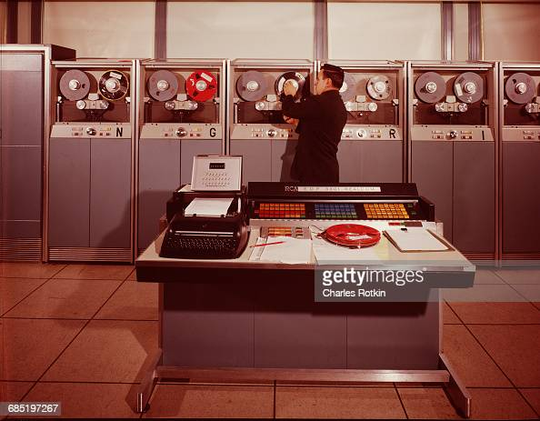 A man adjusts a spool on the RCA computer used in computerized bar code labeling of freight cars at the Association of American Railroads in...
