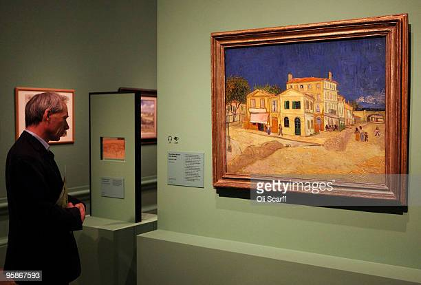 A man admires an oil painting by acclaimed Dutch artist Vincent Van Gogh entitled 'The Yellow House ' in an exhibition of his work held at the Royal...