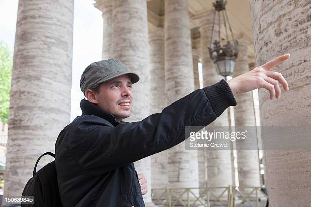 Man admiring architecture in city