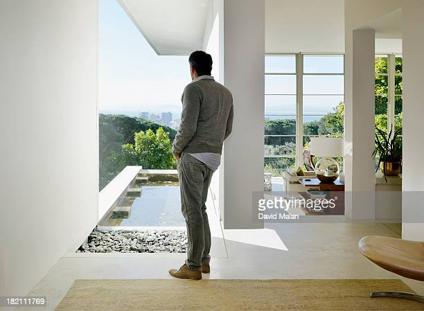 Man admiring the view from a modern home