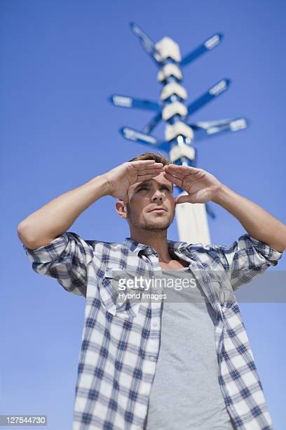 Man admiring view at crossroads