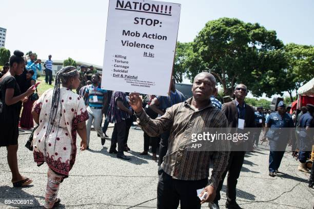 A man advocates to end mob violence within the state funeral ceremony for Major Maxwell Mahama on June 9 2017 in Accra Offduty soldier Maxwell Mahama...
