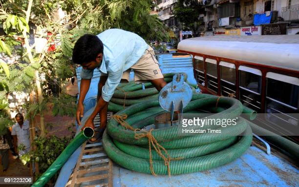Man after filling up the tanker with water for supplying in the area at Girgaum while the area faces a 100% water cut due to the work which begin on...