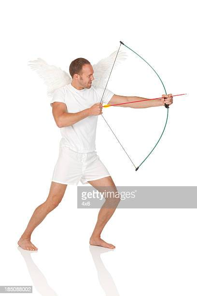 Man aiming with a bow and arrow