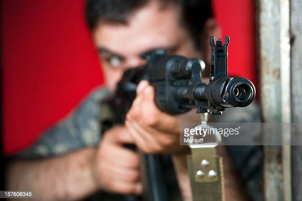 Man aiming with assault rifle AK-47