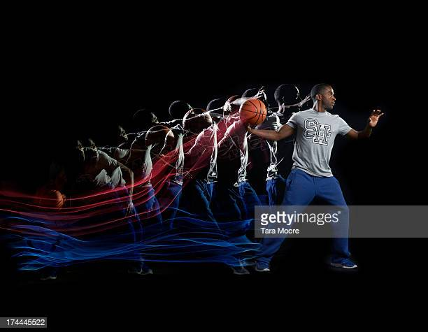 man aiming with basketball and multiple strobe