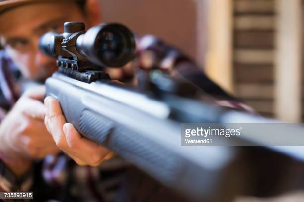 Man aiming with rifle
