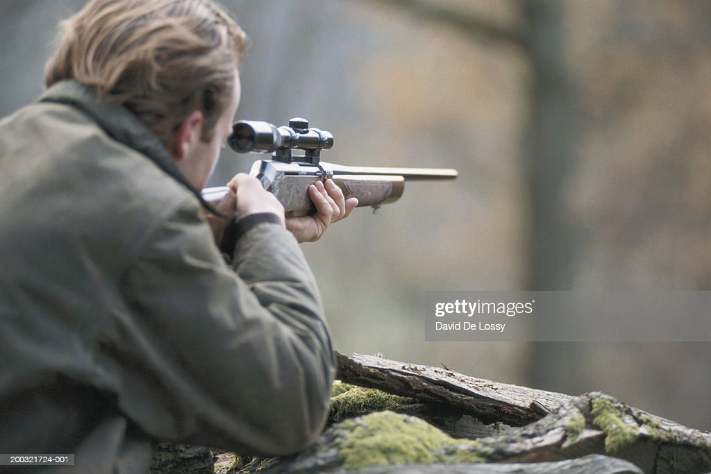 Man Aiming With Shotgun In Forest Rear View Stock Photo ...