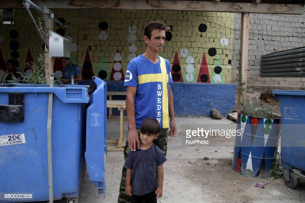 A man and a boy at the Eleonas refugee camp in Athens Greece on Sunday May 6 2017 Approximately 18000 refugees are now in Athens at the Eleonas camp...