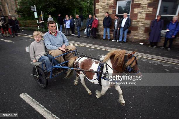 A man and a boy ride a horse down the street at the Appleby Horse Fair June 4 2005 in ApplebyinWestmorland England Appleby Horse Fair has existed...