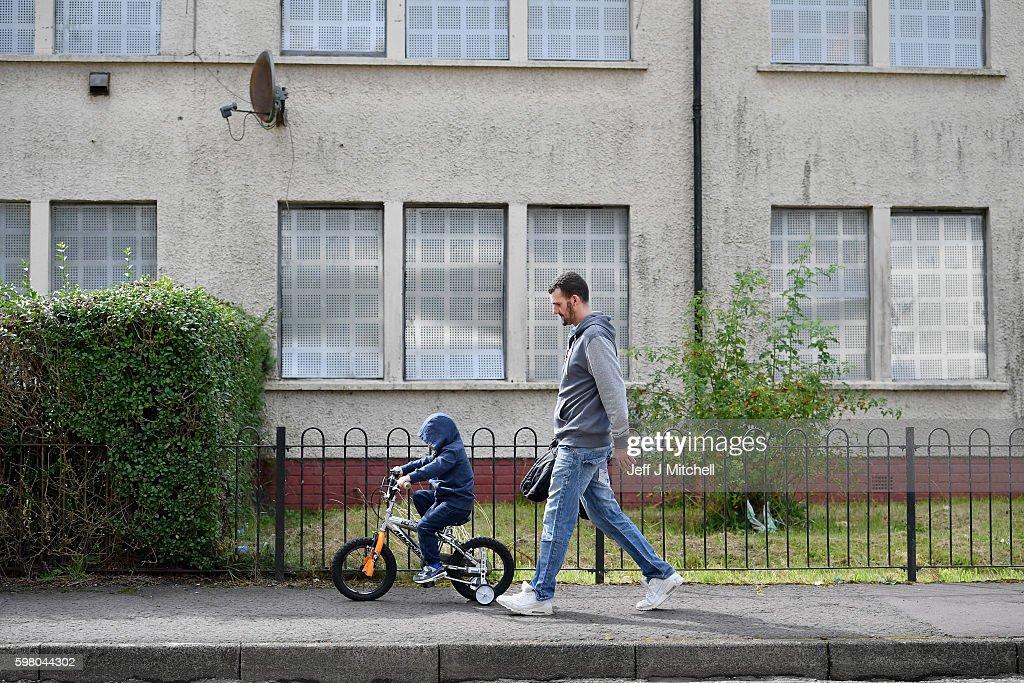 A man and a boy walk through the Tannahill area of Ferguslie Park on August 31 2016 in PaisleyScotland For the second successive year Ferguslie Park...