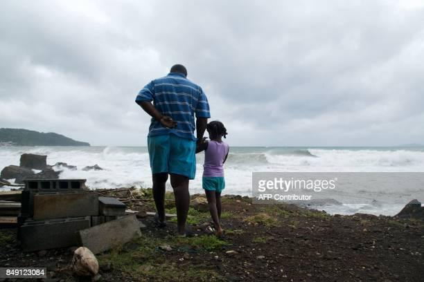 TOPSHOT A man and a girl look at the ocean on September 18 in BasseTerre on the Fench Caribbean island of Guadeloupe as Hurricane Maria approaches...