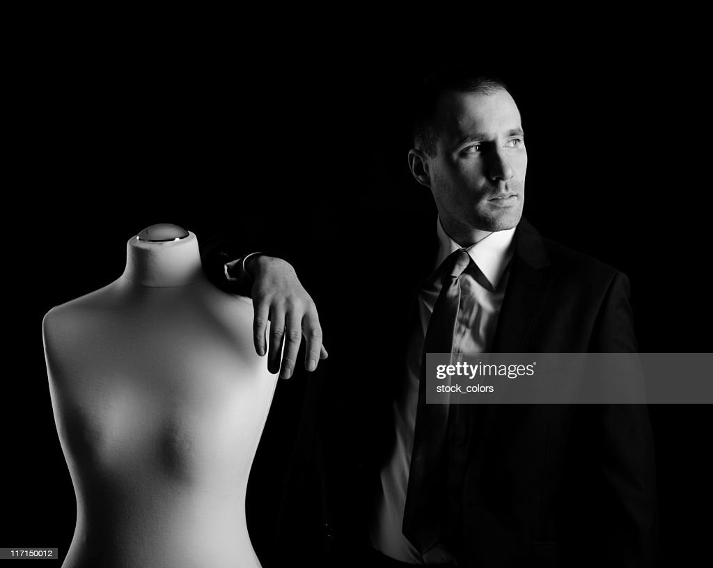 man and a sewing mannequin : Stock Photo