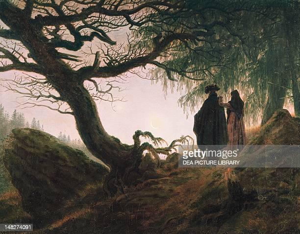 A man and a woman contemplating the moon by Caspar David Friedrich