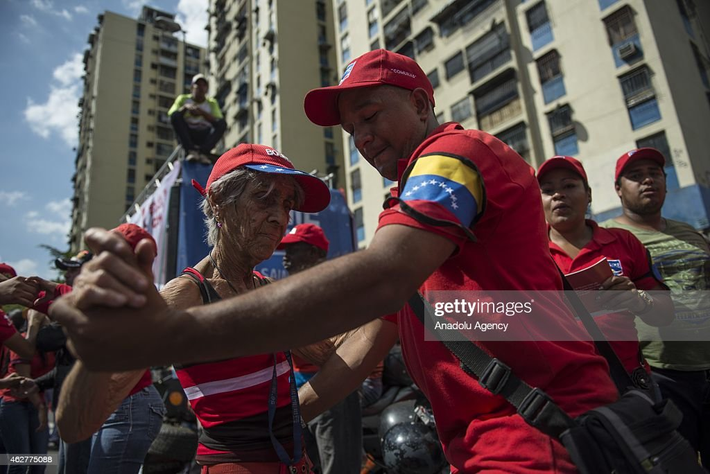 A man and a woman dance during a military parade for the 23rd anniversary of attempted coup of Hugo Chavez against Carlos Andres Perez government on...