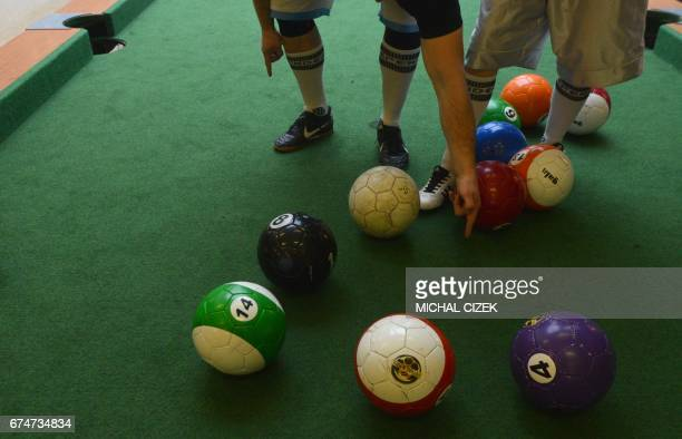 A man and a woman play a footballpool match on April 28 2017 in Prague Footballpool is a combination of football and pool the sport uses inflatable...