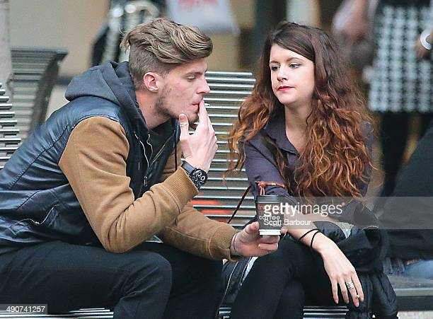 A man and a woman smoke cigarettes in the central business district on May 15 2014 in Melbourne Australia Following a successful smoking ban in the...