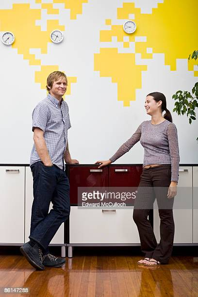 A man and a woman taking a break in an office