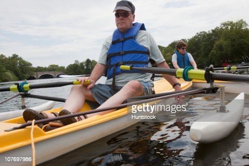 Man and a woman with spinal cord injuries sitting in accessible boats