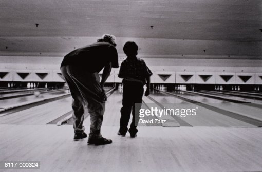 Man and Boy Bowling : Stock Photo