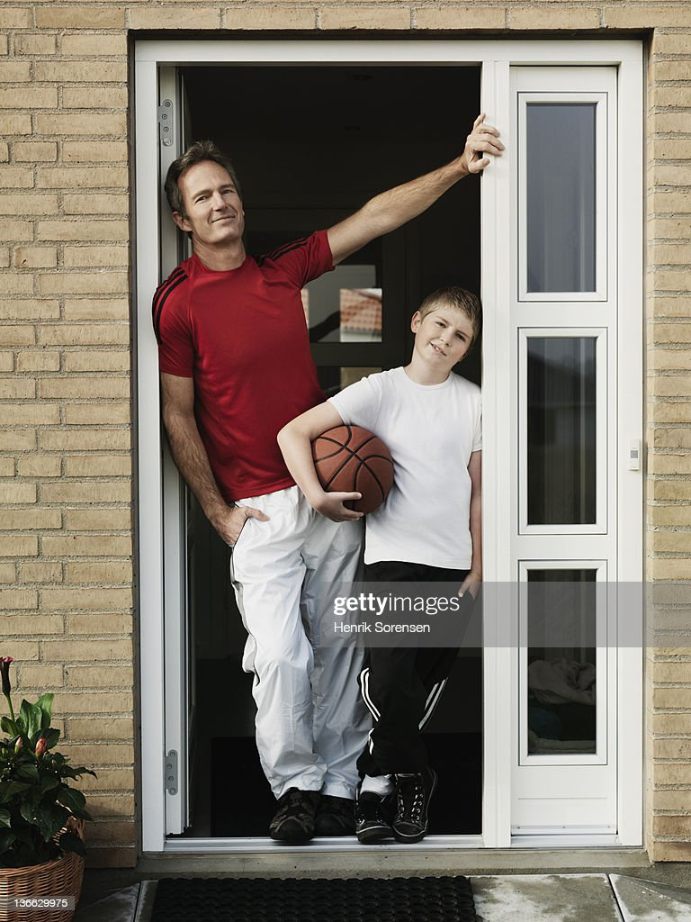 man and boy in door with a ball : Stock Photo