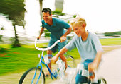 Man and boy on bicycles