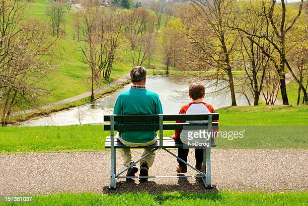 Man and boy on park bench