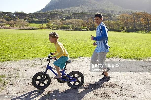 Man and boy playing with bike