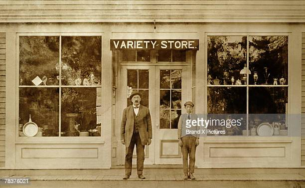 Man and boy standing in front of variety store